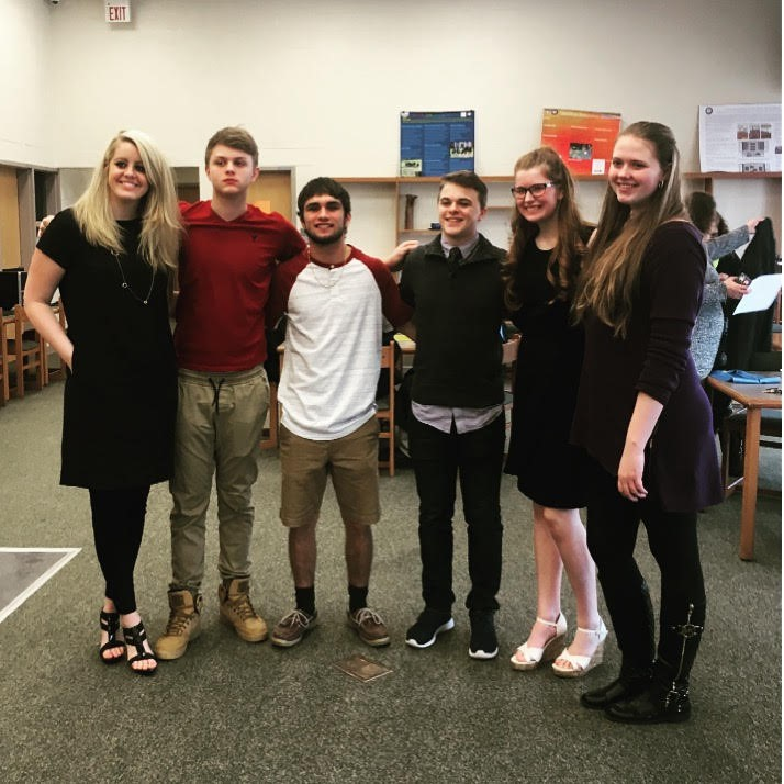 High School NHS students help with the JR High Induction Ceremony.