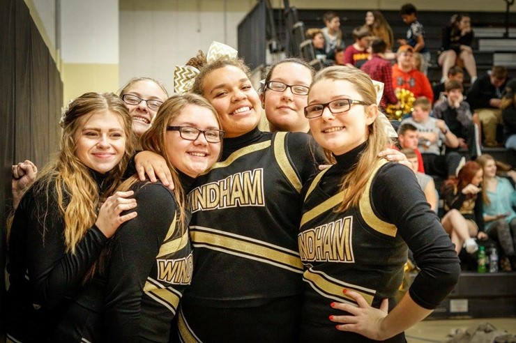 The Basketball Cheer Team is all smiles!