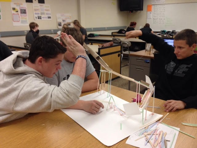 STEM students focus as they test run their marble rollercoaster.