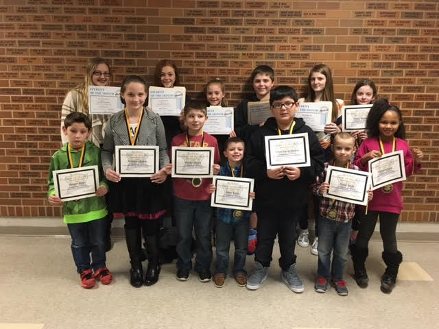 The district's Students of the Month for January and December were honored at the January board meeting.